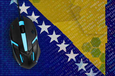 Bosnia and Herzegovina flag  and modern backlit computer mouse. The concept of digital threat, illegal actions on the Internet