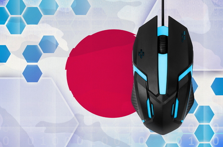 Japan flag  and modern backlit computer mouse. Concept of country representing e-sports team 免版税图像