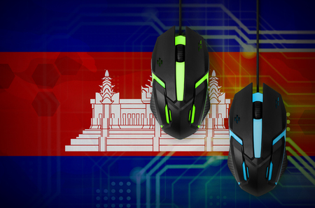 Cambodia flag  and two modern computer mice with backlight. The concept of online cooperative games. Cyber sport team Reklamní fotografie