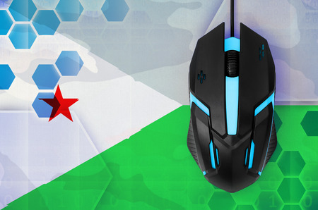 Djibouti flag  and modern backlit computer mouse. Concept of country representing e-sports team Banque d'images - 117142177