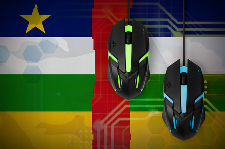 Central African Republic flag  and two modern computer mice with backlight. The concept of online cooperative games. Cyber sport team