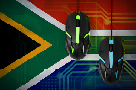 South Africa flag  and two modern computer mice with backlight. The concept of online cooperative games. Cyber sport team Stok Fotoğraf