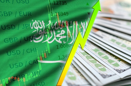 Saudi Arabia flag and chart growing US dollar position with a fan of dollar bills. Concept of increasing value of US dollar currency Stock Photo