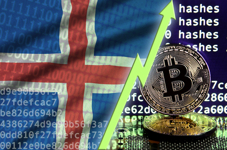 Iceland flag and rising green arrow on bitcoin mining screen and two physical golden bitcoins. Concept of high conversion in cryptocurrency mining