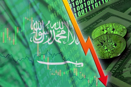 Saudi Arabia flag and cryptocurrency falling trend with two bitcoins on dollar bills and binary code display. Concept of reduction Bitcoin in price and bad conversion in cryptocurrency mining Banco de Imagens