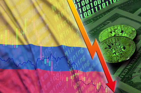Colombia flag and cryptocurrency falling trend with two bitcoins on dollar bills and binary code display. Concept of reduction Bitcoin in price and bad conversion in cryptocurrency mining Stock Photo