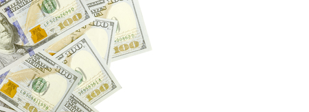 A border of American money isolated on white with copy space. Money Border of hundred dollar bills Banco de Imagens