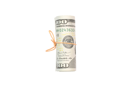 US dollars rolled up and tightened with band isolated on white background. American money 版權商用圖片