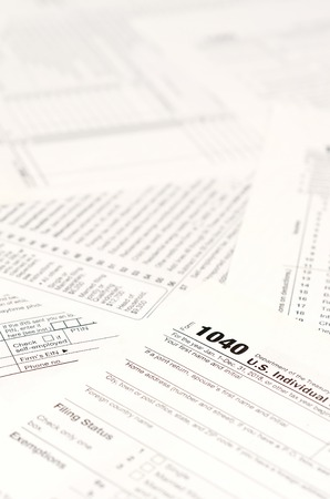 Blank income tax forms. American 1040 Individual Income Tax return form. Papers with empty and unfilles lines