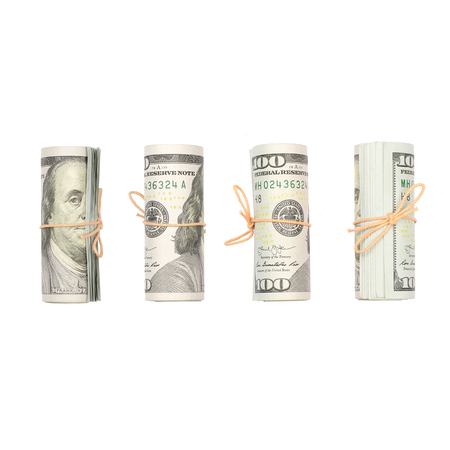Several bundles of US dollars isolated on white background. Minimalistic composition and business concept