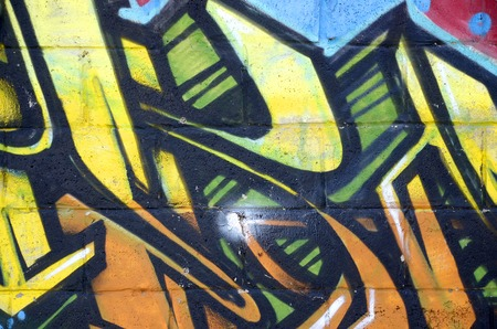 Fragment of colored street art graffiti paintings with contours and shading close up. Background texture of youth contemporary art culture. Yellow orange and brown colors Redakční