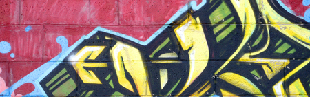 Fragment of colored street art graffiti paintings with contours and shading close up. Background texture of youth contemporary art culture. Yellow orange and brown colors