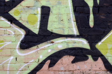 Fragment of colored street art graffiti paintings with contours and shading close up. Background texture of youth contemporary art culture. Green yellow colors Archivio Fotografico