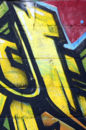 Fragment of colored street art graffiti paintings with contours and shading close up. Background texture of youth contemporary art culture. Yellow orange and brown colors Stok Fotoğraf