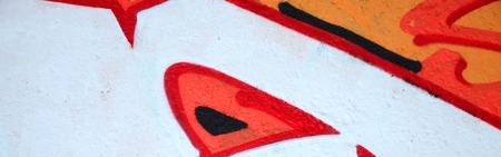 Fragment of colored street art graffiti paintings with contours and shading close up. Background texture of youth contemporary art culture. Orange, red and black colours Stock Photo