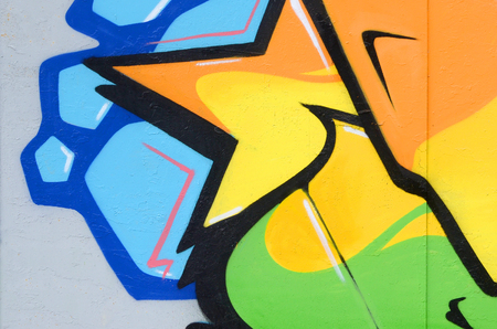 Fragment of colored street art graffiti paintings with contours and shading close up. Background texture of youth contemporary art culture. Orange yellow and green colors Stock Photo