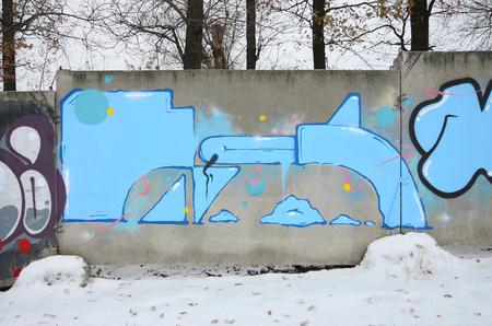 Fragment farbiger Street-Art-Graffiti-Gemälde mit Konturen und Schattierungen aus nächster Nähe. Hintergrundtextur der Jugend zeitgenössischer Kunstkultur. Blaue und schwarze Farben