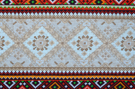 Traditional Ukrainian folk art knitted embroidery pattern on textile fabric. Colored pixel design knitted canvas.