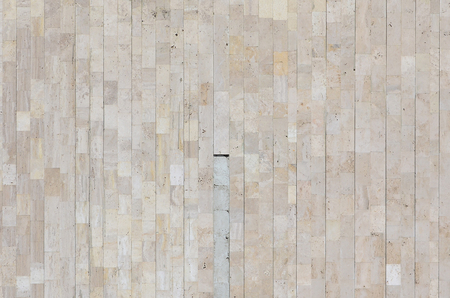 Background texture of old matte beige marble wall from a variety of large tiles
