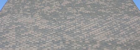 Flexible shingles of bitumen roofing surface. Background mosaic texture of flat roof tiles with bituminous coating