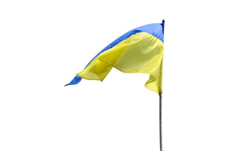 Ukrainian flag fluttering in the wind against white background. Presidential elections in Ukraine 2019. Blue and yellow Ukrainian national flag isolated on a flagpole with copy space for text Reklamní fotografie