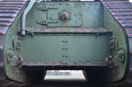 Texture of tank side wall, made of metal and reinforced with a multitude of bolts and rivets. Image of covering of a combat vehicle from the Second World War Reklamní fotografie