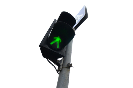 Traffic lights with the green light lit isolated on white. Optical device that supplies light signals that regulate the movement of road transport