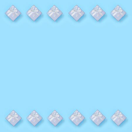 A lot of blue gift boxes lies on texture background of fashion pastel blue color paper in minimal concept. Abstract trendy pattern.
