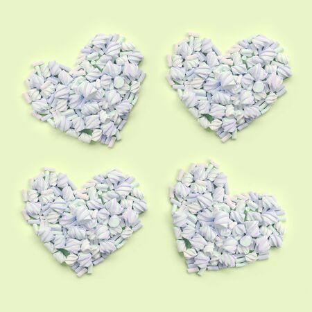 Colorful marshmallow laid out on lime and pink paper background. pastel creative textured hearts. minimal. Stock Photo
