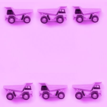 Many small purple toy trucks on texture background of fashion pastel purple color paper in minimal concept.