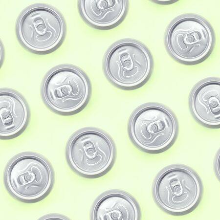 Many metallic beer cans on texture background of fashion pastel lime color paper in minimal concept.