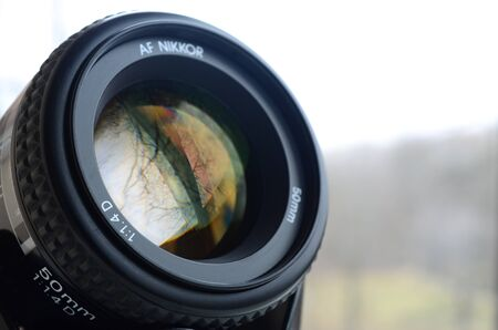 KHARKIV, UKRAINE - JAN 9, 2018: Nikon AF NIKKOR 50mm 1:1.4D photographic lens close up. Nikon is a multinational corporation specializing in optics and imaging products Editoriali