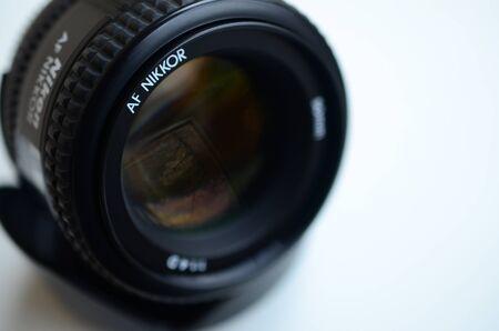 KHARKIV, UKRAINE - JAN 9, 2018: Nikon AF NIKKOR 50mm 1:1.4D photographic lens close up. Nikon is a multinational corporation specializing in optics and imaging products Editorial
