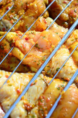 Delicious chicken legs on garden grill. Marinated Chicken Legs On The Hot BBQ Charcoal Grill. Good Snack For Outdoor Weekend Party or Picnic
