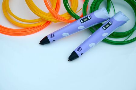 Top view on 3d pen and kit of colourful ABS plastic filament on white background.