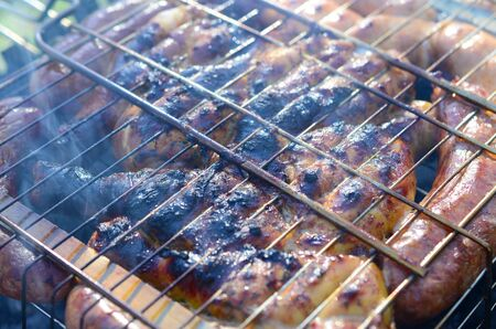 Toasted meat with overcooked crust. Marinated Chicken Legs On The Hot BBQ Charcoal Grill Poor and improper cooking meat on fire Stock fotó