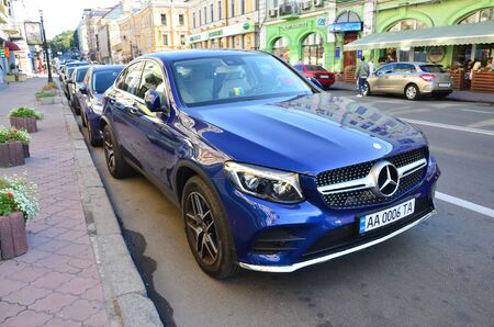 KYIV, UKRAINE - SEPTEMBER 19, 2017: Mercedes Benz CLS 500 4MATIC blue color on Kyiv streets. Mercedes-Benz is a German automobile manufacturer is used for luxury automobiles