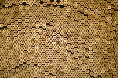Pattern of 12 gauge cartridges for shotgun bullets. Shells for hunting rifle close up. Backdrop for shooting range or ammunition trade concepts. Used 12 caliber cylinder cooper caps in stack Фото со стока - 133477102