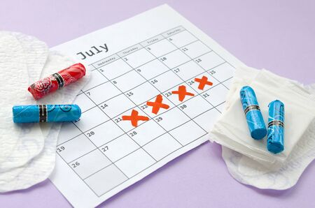 Aspects of women wellness in monthlies period. Menstrual pads and tampons on menstruation period calendar. Woman critical days, gynecological menstruation cycle period. Sanitary woman hygiene Stok Fotoğraf