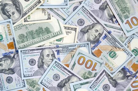 Top view of one hundred dollar banknotes made background. USD currency concept and rich life. Texture of american dollar bills. Stock Photo