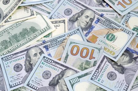 Top view of one hundred dollar banknotes made background. USD currency concept and rich life. Texture of american dollar bills.