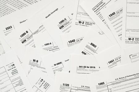 Many tax form blanks lies on table close up. Tax payers paperwork routine and bureaucracy concept. Need help with tax problems 写真素材 - 132117015