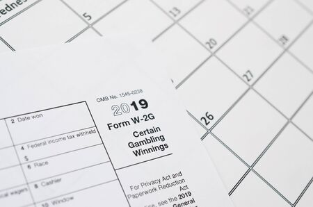 IRS Form blank lies on empty calendar page. Tax period concept. Copy space for text 写真素材