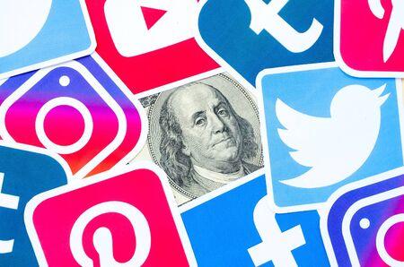 KHARKOV, UKRAINE - OCTOBER 3, 2019: Benjamin Franklin hundred dollars bill portrait with printed logo of many social networks. Facebook Instagram Youtube Tumblr Twitter Pinterest