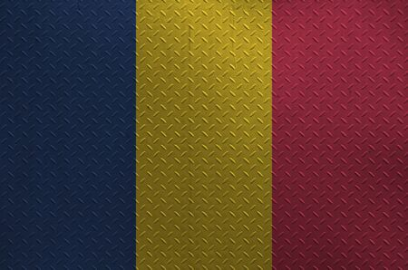 Chad flag depicted in paint colors on old brushed metal plate or wall close up. Textured banner on rough background
