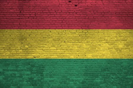 Bolivia flag depicted in paint colors on old brick wall close up. Textured banner on big brick wall masonry background