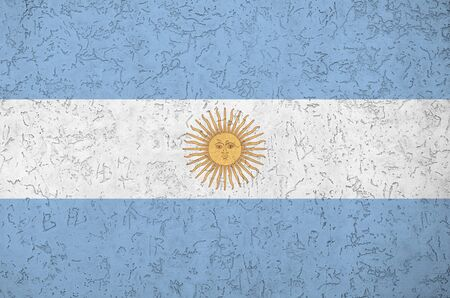 Argentina flag depicted in bright paint colors on old relief plastering wall close up. Textured banner on rough background Stock Photo