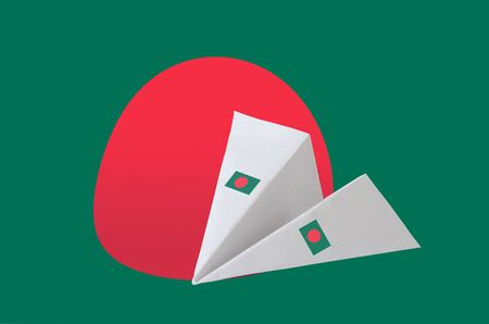 Bangladesh flag depicted on paper origami airplane. Oriental handmade arts concept