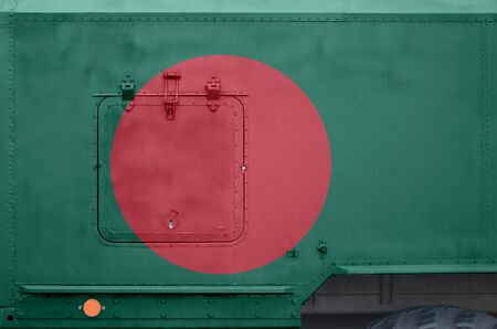 Bangladesh flag depicted on side part of military armored truck close up. Army forces vehicle conceptual background