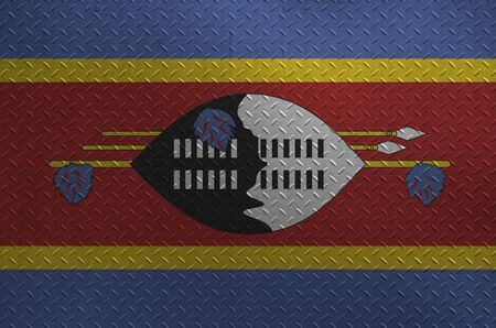 Swaziland flag depicted in paint colors on old brushed metal plate or wall close up. Textured banner on rough background